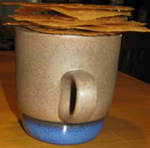 lace cookies stacked on Heathware cup